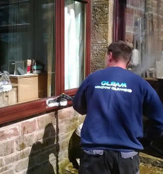 Washing windows on a house in Gretna