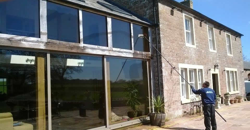 cleaning windows in Longtown with our pure water system