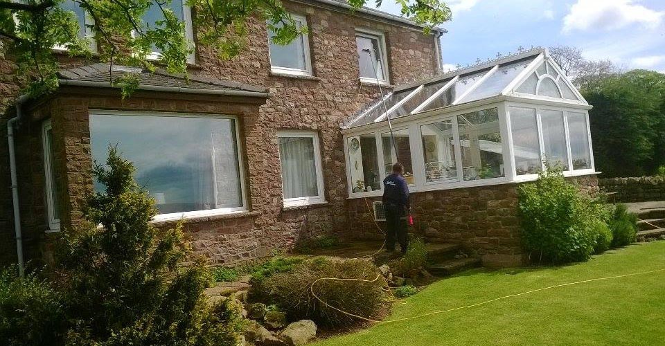 Washing an awkward window above a conservatory in Gair